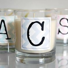 These personalized candle wedding favors would be easy to make using Avery square labels and free design software.