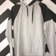 Gray Hoodie with Faux Leather Shoulders Pair this trendy top with a pair of Skinnies and Moto Boots for an edgy look! Forever 21 Tops Sweatshirts & Hoodies