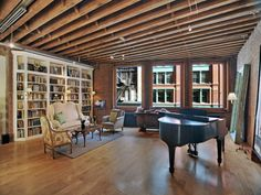 Love the tapered triangular end unit of the bookcase. Nice. (Taylor Swift's NY penthouse)