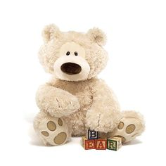 """GUND is proud to introduce Philbin — one of our most popular character bears in an 18"""" beige seated plush toy format. This classic design features cute paw pad accents and a curious expression that's impossible not to love! As always, high-quality and huggable soft plush ensures that GUND products remain loyal pals for years to come. Surface-washable. Appropriate for ages one and up. About GUND: For more than 100 years, GUND has been a premier plush company recognized worldwide for quality…"""