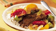Slow-Cooker Pepper Steak - easy and delicious. Saute the beef in olive or grapeseed oil, use arrowroot and tamari (instead of cornstarch and soy sauce), and serve over 1/2 cup cooked quinoa per serving for Phase 3.