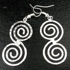 Hammered Scroll Silver Overlay Earrings Handmade and Fair Trade. Handcrafted by woman artisans in Mexico, these elegant double-swirl textured earrings are silver plated and hang inches from hypoallergenic hooks. Abalone Jewelry, Silver Jewelry, Silver Rings, Gold Jewellery, Silver Bracelets, Earrings Handmade, Handmade Jewelry, Unique Earrings, Handmade Silver