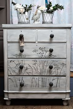 Victorian chest of drawers. This one has been given the weathered paint look in grey and white and has a cow parsley design stenciled on the drawers, definitely one of a kind :)