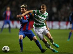 Lionel Messi of Barcelona (L) and Jozo Simunovic of Celtic (R) battle for possession during the UEFA Champions League Group C match between Celtic FC and FC Barcelona at Celtic Park Stadium on November 23, 2016 in Glasgow, Scotland.