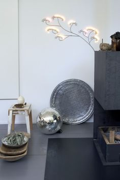 mirror ball , cool wall light and a hammered tray
