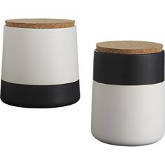 hip dip.  Smooth handmade stoneware cylinder goes graphic in a hip dip of matte black/white.  Keeps coffee, tea or nuts contained with major counter appeal, topped with a round of natural cork.  Play opposites with dip black/white large canister. Handmade stonewareTwo-tone black/white matte dip glazeCork lidCanister is dishwasher-safe; wipe cork lid with clean, damp cloth.