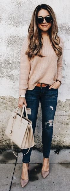Blush sweater, shoes and handbag with dark blue distressed jeans.
