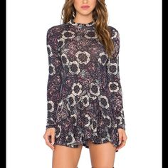 "NWT free people Annabelle mini dress/tunic🎉🎉HP🎉 Details: Vintage floral print covers mock neck tunic with a cutout back and ruffled hem. - Mock neck - Long sleeves - Approx. 32"" length - Imported Fiber Content: 70% rayon, 30% linen Care: Hand wash cold Additional Info: Fit: this style fits true to size.  Model's stats for sizing: - Height: 5'9.5"" - Bust: 32"" - Waist: 24.5"" - Hips: 36"" Model is wearing size S. Free People Tops Tunics"