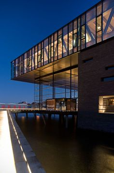 The New Royal Playhouse (Det Nye Skuespilhus) sits on the Copenhagen harbor, a calm monument to culture and a nuanced design that reflects a respect for its place. The building, by Danish firm Lundgaard and Tranberg Arkitekter, is completely contemporary and yet seems as though it has always been there.
