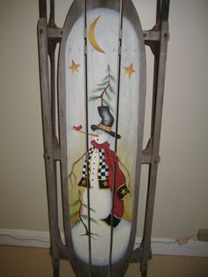 This cute little snowman is a Cindy Mann Vitale design.  I painted him as a special order on a large size sled.