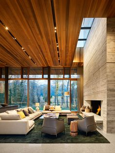 While texture and color reflecting the personality of the client are introduced in interior furnishings throughout the Riverbend residence, the overall restraint of the architectural palette creates a built experience that has the feel of a quiet platform set amidst the trees. Residential architecture and interior design by CLB in Jackson, Wyoming – Bozeman, Montana. #interiorarchitecture #interiordesign #fireplace #livingroom #seating #interiorinspiration #designinspo Living Area, Living Spaces, Living Rooms, French Property, Wood Ceilings, House Made, House 2, Window Wall, Architect Design