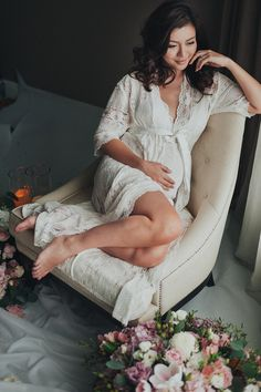 Wonderful robe from Bells & Birds on our expecting mother as she reclines in her sofa amongst gorgeous blooms // Earlier this year we featured Miss Universe Malaysia Carey Ng's helipad wedding, and today we're delighted to share our styled maternity shoot photos with the bride-turned-mother-to-be. Carey is in the pink of health and glows in these images captured by Munkeat and styled by Agnes of Prep at The Majestic Hotel Kuala Lumpur.