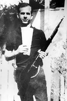 Lee Harvey Oswald was the accused assassin of President John F. Kennedy on November 22, 1963. He was murdered two days later by Jack Ruby as he was being escorted from the city jail to the county jail. This photo is showing Oswald with a rifle he had purchased.