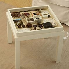 Make a memory box table tutorial.     Turn a deep photo frame and similar-sized side table into a venue for celebrating treasured keepsakes.