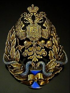 A VERY FINE antique Imperial Russian gilded silver and blue enamel physician badge, made in Moscow around 1897.