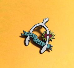 Image of Born Lucky Hard Enamel Pin Humble Brag with this lucky charm enamel pin and help support adoption!