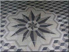 piso de cemento pintado.  www.naturalarearugs.com