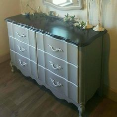 This Vintage Dresser is painted a chalk Taupe/Gray color with white...