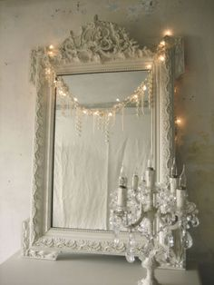 Beautiful, ornate mirror ~ I even love the tiny lights draped across it~❥