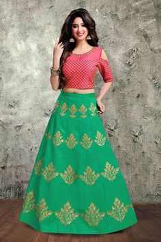 Style like a fashion goddess wearing this classic vibrant combination of pink and green in this scintillating art silk lehenga; décor with a traditional touch of elegance this lehenga is all glammed up with huge zari motifs placed in an ascending pattern. The choli is embellished all over by zari criss-cross work with a modish sheer boat neckline and tailored with a stylish cold shoulder sleeves that is emphasizing the beauty of the garment. This lehenga is accompanied with only choli and…