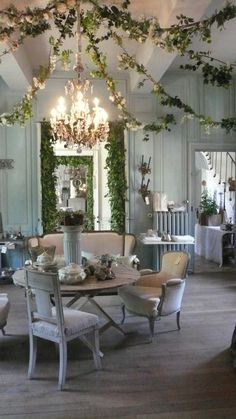 Beautiful.  Love the garland and the chandelier in the center.  Might be able to do something like this in courtyard area for a party!