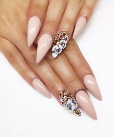 Sleek, sexy and totally trending, pointy nails slim your digits while allowing for some pretty incredible nail art designs