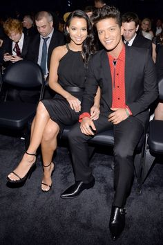 GRAMMY winner Bruno Mars and model Jessica Caban at the 56th Annual GRAMMY Awards on Jan. 26 in Los Angeles