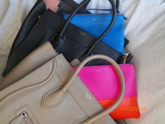 A Celine Rainbow:  Envelope Mini Luggage in Anthracite; Mini Luggage in Camel; Bi-Color Pouch in Hibiscus; Trio Bag in Bright Blue