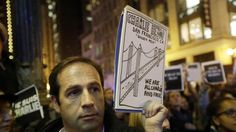 """""""I am Charlie' Goes Viral after Paris news attack 1-8-15 Regis Denon, of Paris, France, holds a sign in remembrance at a gathering in solidarity with those killed in an attack at the Paris offices of the weekly newspaper Charlie Hebdo on Wednesday, Jan. 7, 2015, outside of the French Consulate in San Francisco. A handful of participants in the Wednesday night vigil in San Francisco's financial district are lighting candles that spell out &quo"""