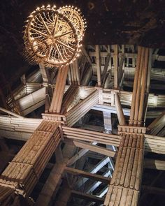 Wieliczka Salt Mine - these massive wooden beams are keeping this whole room up!  #saltmine #salt #mine #krakow #poland #salty #chandelier #architecture #archilovers #stairs #adventure #underground #deep #church #old #design #chapel #trippics #instapic #instagood #explore #travel #architectureporn #history #historicalvibes #picoftheday #photograph #photo #wonderful_places by sophiejowatson