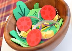 Make a kids play salad by cutting lettuce out of green craft foam and tomatoes out of red foam. Add details to them using markers. Cut up yellow foam into cubes as cheese or croutons. Olives....?
