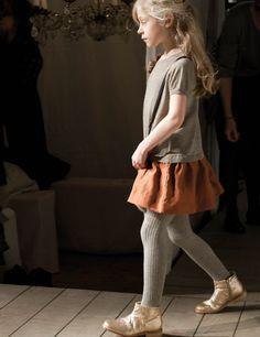 Skirt + tights + flat hightops.