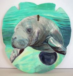 A Manatee painted on a natural Sand Dollar by Artist Gail Dolphin Painted Sand Dollars, Sand Dollar Art, Sea Glass Mosaic, Sea Cow, Ocean Creatures, Shell Art, Ocean Art, My Spirit Animal, Wildlife Art