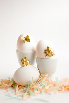 Transform your Easter Eggs into 3D. Make this sweet, simple gold animal Easter Eggs DIY. Gold paint and glitter brings charm to these spring-time animals.