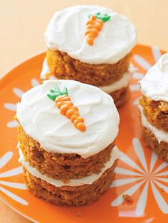 Love the little piped carrots on these mini carrot cakes (Plus 7 Scrumptious Carrot Dessert recipes)