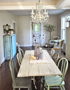 gorgeous cottage kitchen- love the mix of chairs, and touch of pale pumpkins for fall #EclecticallyFall