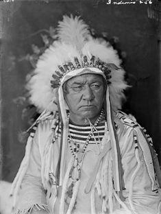 Blackfoot man wearing war bonnet with small brass bells above brow band - ca 1900-1920