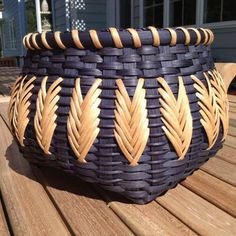 This basket was woven by Alice Schaub. The original pattern is by Sheridan Cody. Love the color & feather design!
