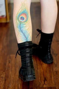 Peacock feather tattoo Wish the boots weren't covering it