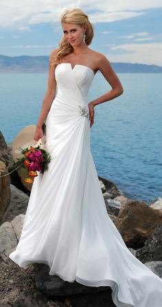 beautiful beach wedding dresses and wedding flower love it