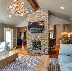 RSU Contractors creative approach to turning a large room into a cozy multi-functional space. Adding a two-sided fireplace is a unique way to provide room division.   #fireplace #rsucontractors #remodel #renovation