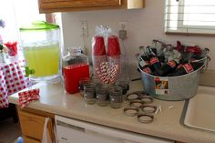 """1950s housewife Theme Bridal Shower drink station: fresh lemonade, mason jars with ribbon tied around the middle, spray chalk lids and poke whole with hole puncher and add a decorative straw. Tin tub filled with """"Mexican cokes"""" also include 1950's COKE ad for some personality!"""