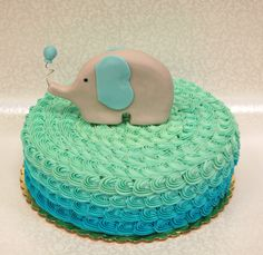 Adorable baby shower cake (or birthday cake!) with an ombre rosette and an edible sculpted elephant. Super cute! #cutecakes #babyshower #elephantcake #ombre #rosette #awesomecakes #sweetlifedesserts