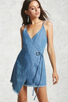 Forever 21 Contemporary - A chambray dress featuring a surplice neckline, adjustable cami straps, a self-tie wrap design with an O-ring and frayed hem.