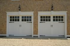 Country style garage door. Would look adorable with simple portico and planter boxes but prob in a diff accent color. Something other than white!