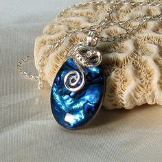 Paua Shell Necklace - Abalone Pendant - Paua Shell jewelry - Mother of Pearl - Sterling Silver. $45.00, via Etsy.