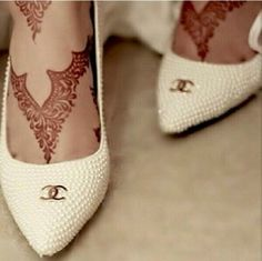 Here's an idea - design the henna to complement the shoe! Brilliant!
