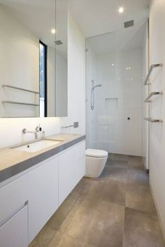 Small bathroom ideas and small bathroom designs for both city and country homes. From small bathroom designs using tile and wallpaper, to help decide on a small bathroom layout. Long Narrow Bathroom, Modern Small Bathrooms, Bathroom Layout, Modern Bathroom Design, Bathroom Interior Design, Bathroom Ideas, Bathroom Designs, Bathroom Organization, Contemporary Bathrooms
