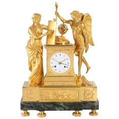 Large French Empire Mantel Clock 'Genie et Imagination', Clodion circa 1810 | From a unique collection of antique and modern clocks at http://www.1stdibs.com/furniture/more-furniture-collectibles/clocks/