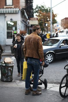 Brown boots, denims, brown leather jacket, brown felt hat and short beard. Awesome!!!